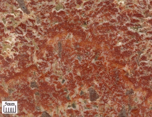 The colouring is caused by red hematite